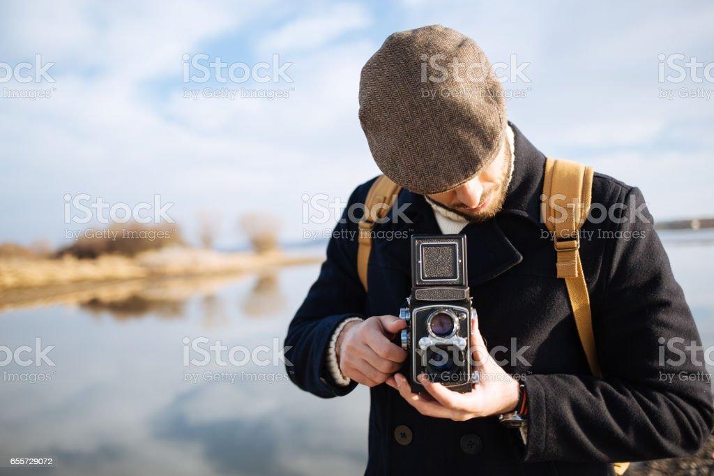 Photographer with vintage photo camera stock photo