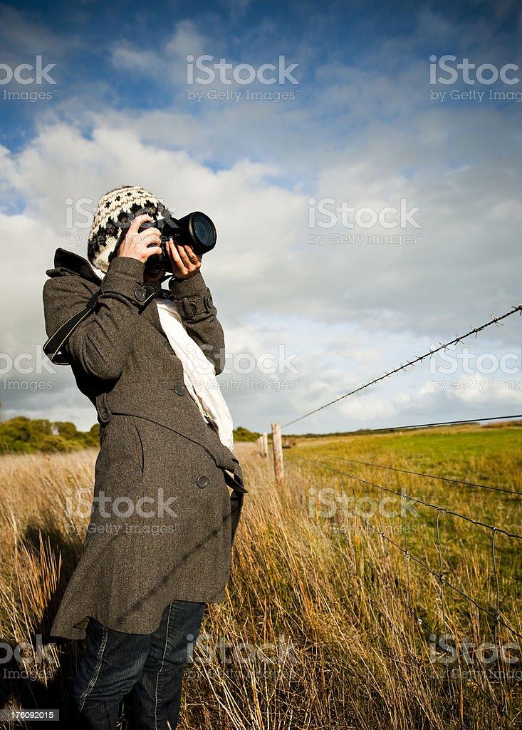 Photographer woman composing photo farm fence outdoors stock photo