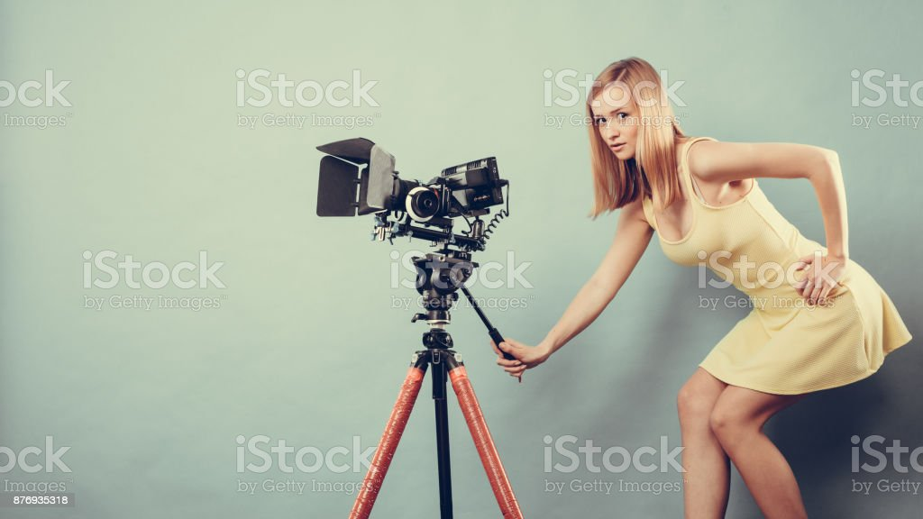 Photographer woman with camera taking photos stock photo