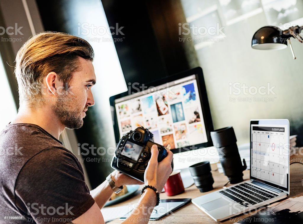 Photographer Working Checking Photo Concept stock photo