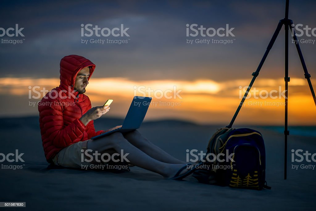 Photographer working outside in the early morning stock photo