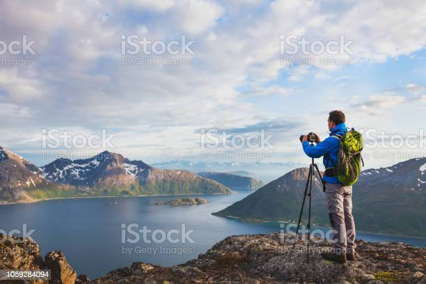 Photographer working with tripod and dslr camera picture id1059284094?b=1&k=6&m=1059284094&s=612x612&h=rkcxg3qd2wu2h i2ujufuuys8ii04r ik1gbvkyqv 4=