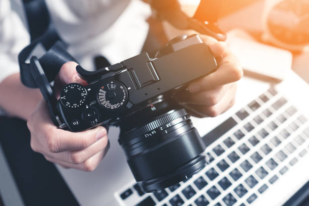 photographer workplace - camera photographic equipment stock photos and pictures