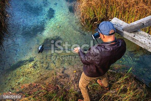 Photographer works underwater images, Julian Alps, Zelenci, Gorenjska, Julian Alps, Slovenia, Europe,Nikon D850