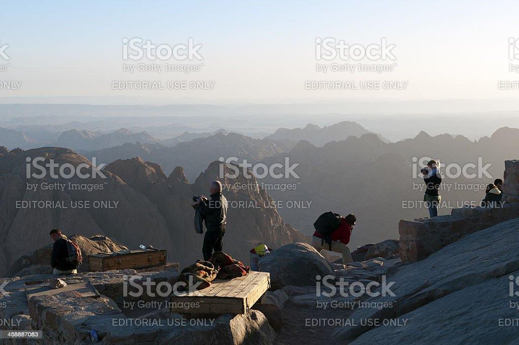 Photographers atop Mount Sinai in Egypt royalty-free stock photo