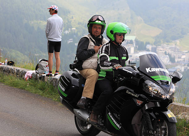 """Photographer's Bike """"Beost, France, July 15th 2011: Image of an official photographer's motorbike passing before the arrival of the peloton on the category H mountain pass Aubisque, during the 13th stage of Le Tour de France 2011."""" kawasaki heavy industries stock pictures, royalty-free photos & images"""