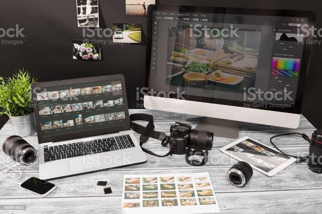 Photographers computer with photo edit programs. stock photo