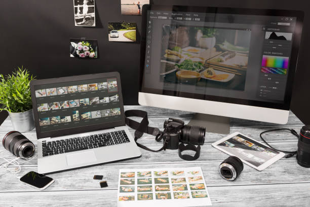 photographers computer with photo edit programs. - camera photographic equipment stock photos and pictures