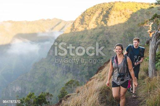 istock Photographers hiking up Hawaii mountain 954787370