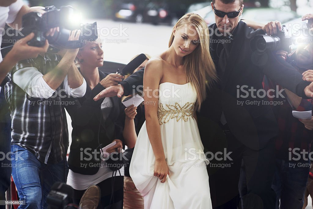 Photographers taking photos of celebrity couple stock photo