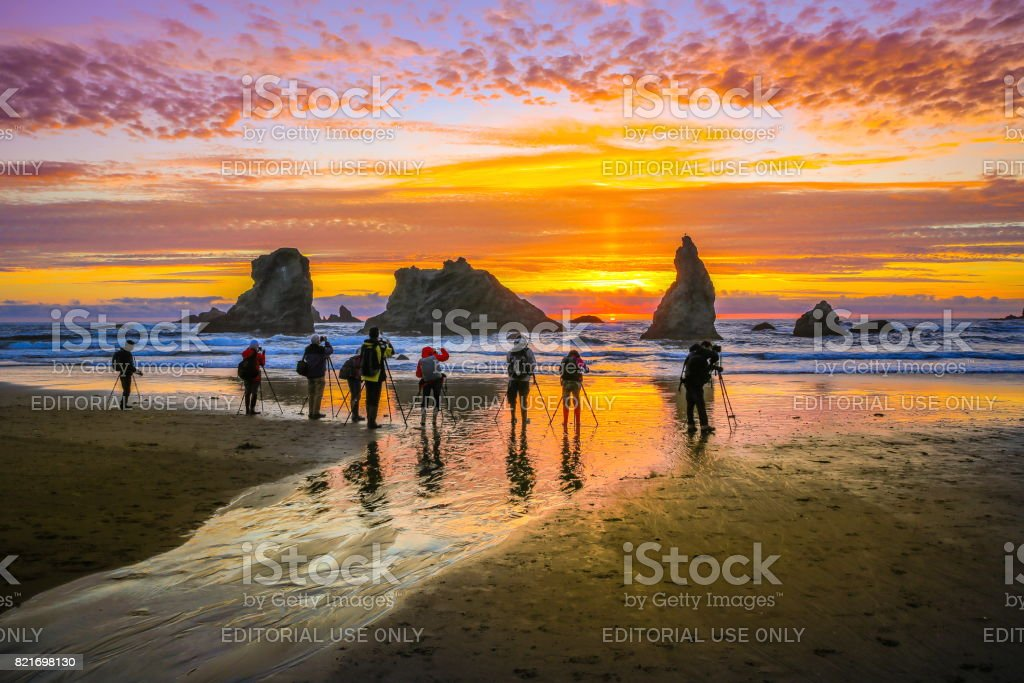 Photographers taking photos on Bandon Beach, Oregon stock photo