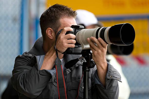 photographers with telephoto lens - telelens stockfoto's en -beelden