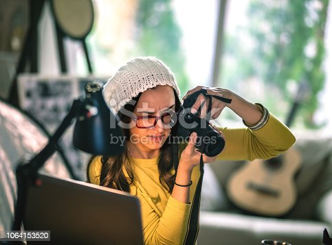 Photographers Working In Their Office