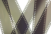 Photographic film background. 35mm negative film tapes on a white background. Analog/film photography background.