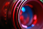 Photographic lens, close-up n abstract color illuminated.