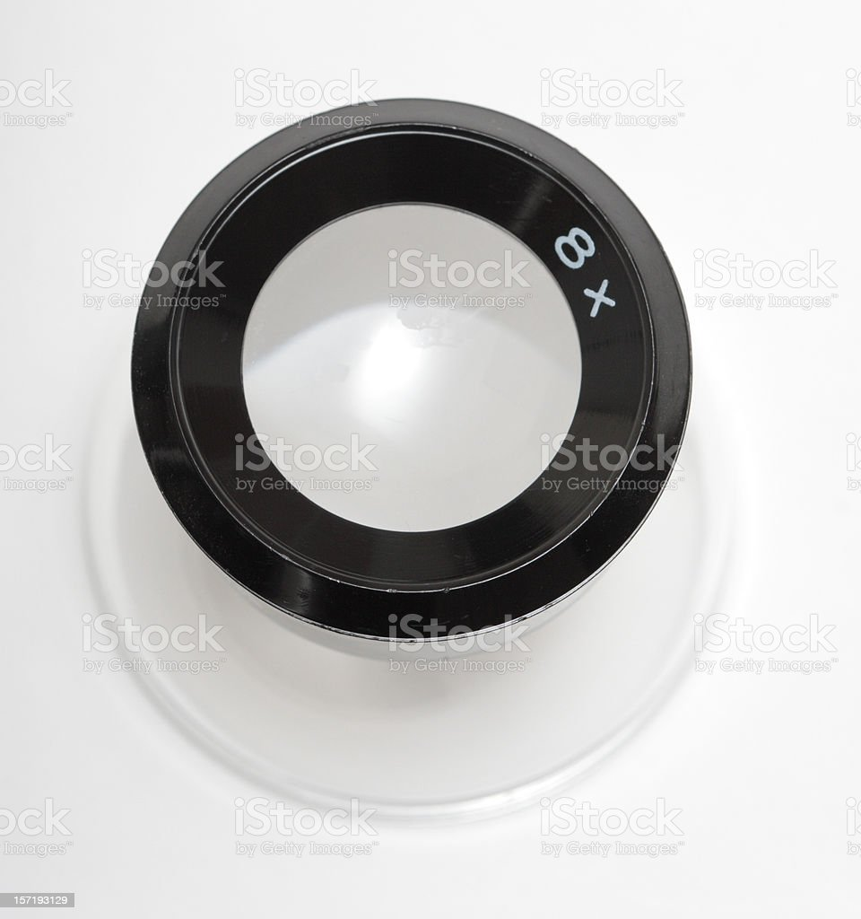 Photographic Loupe on White Surface royalty-free stock photo