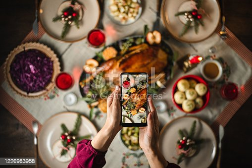 istock Photographing Christmas dinner with a smart phone 1226983958