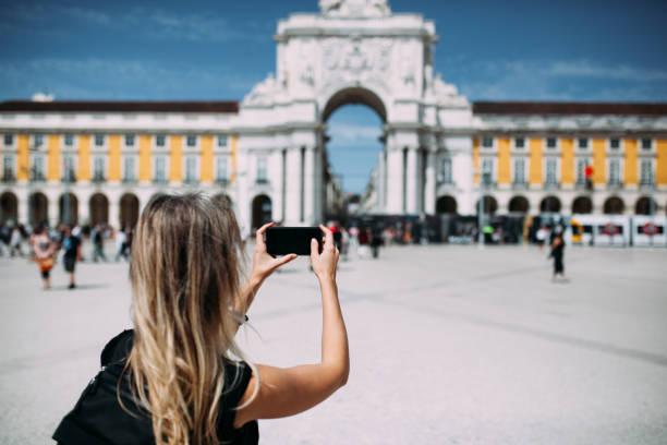 Photographing Comércio Plaza in Lisboa stock photo