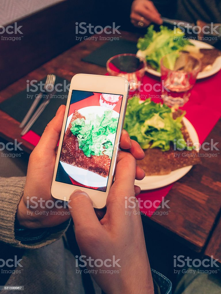 Photographing dish at the restaurant stock photo