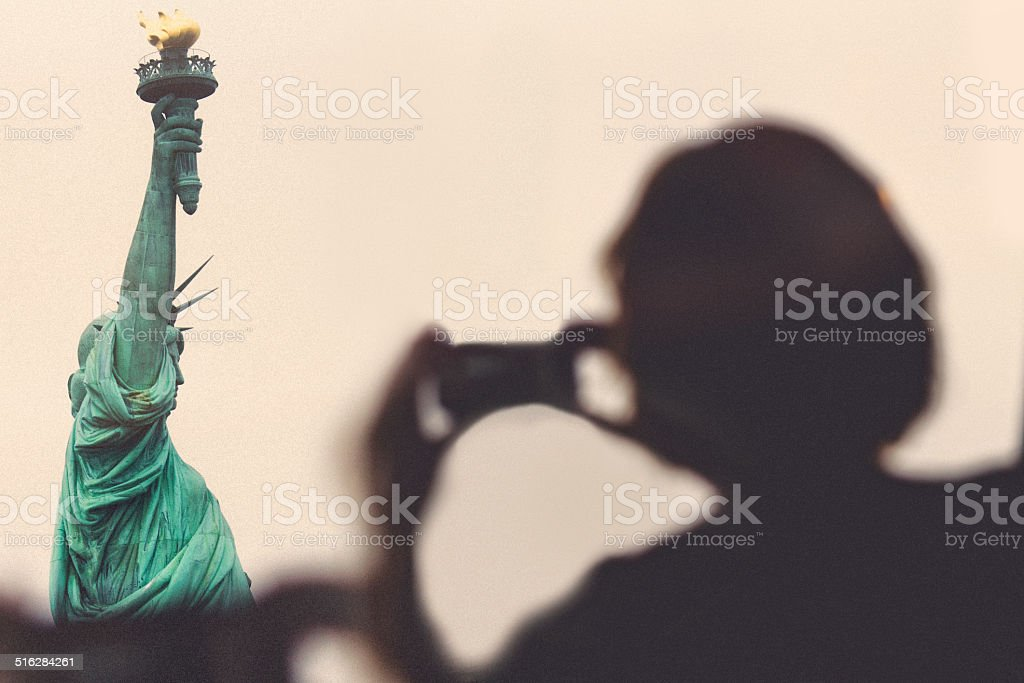 Photographing Lady Liberty stock photo