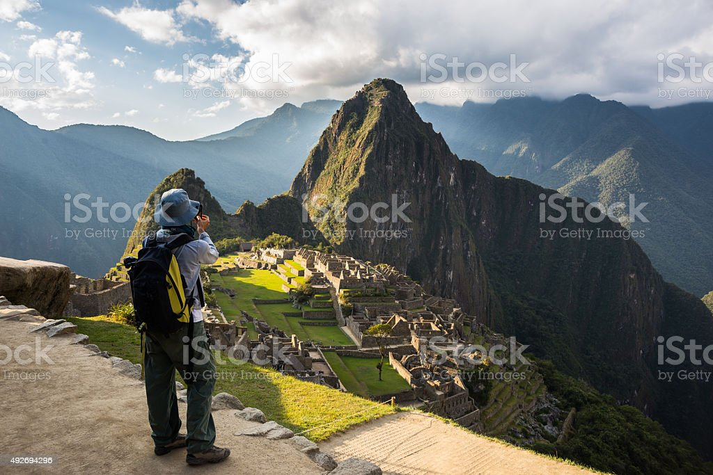 Photographing Machu Picchu with smartphone stock photo