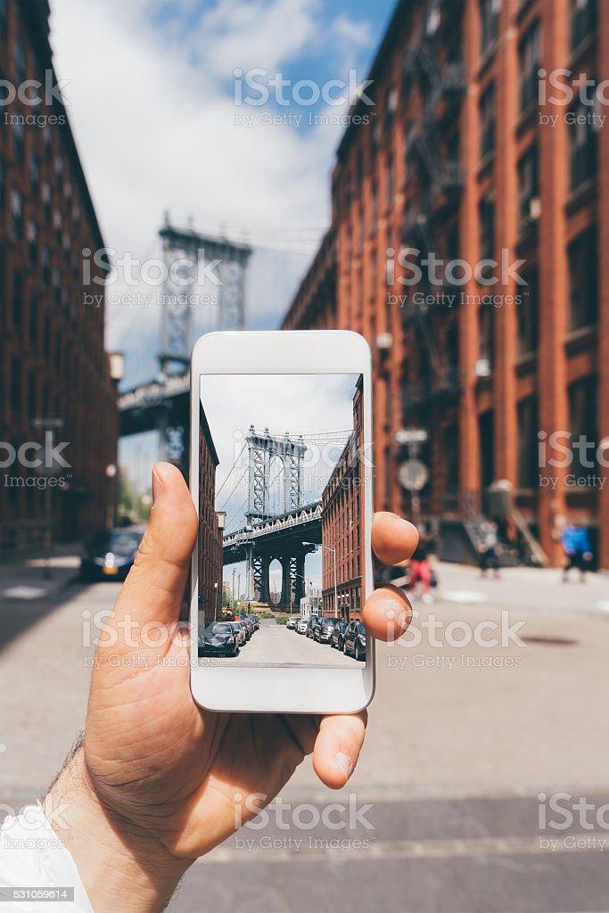 Fotografieren Manhattan Bridge in New York mit dem Smartphone Lizenzfreies stock-foto