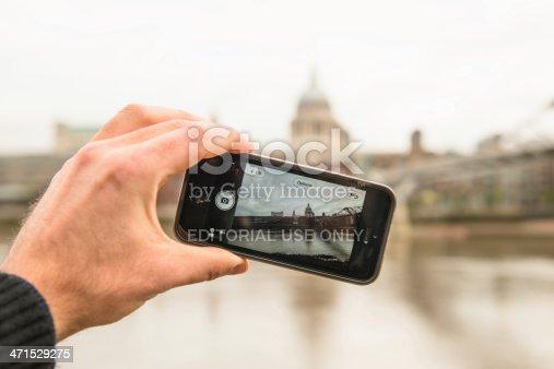 599114758 istock photo photographing millenium bridge with iphone 5 471529275