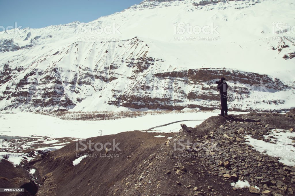 Photographing snowcapped Himalayas mountain royalty-free stock photo