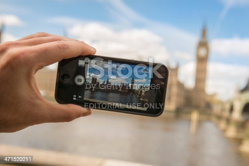 599114758istockphoto photographing the Big Ben tower with iphone 5 471520211