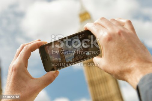 599114758istockphoto photographing the Big Ben tower with iphone 5 471520213