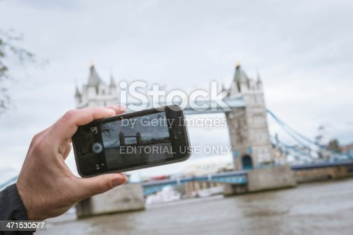 599114758 istock photo photographing the tower bridge with iphone 5 471530577