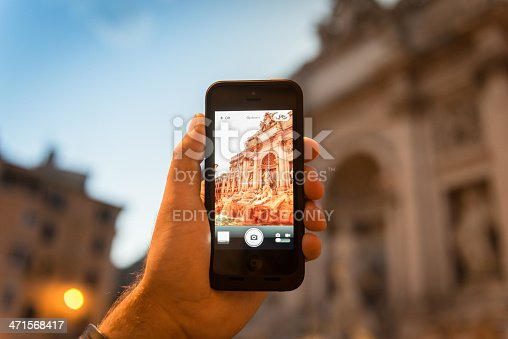 599114758 istock photo photographing the Trevi Fountain in rome 471568417