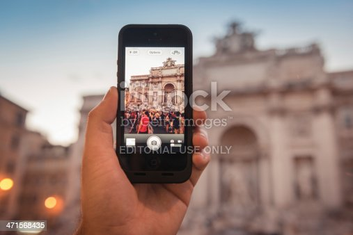 599114758 istock photo photographing the Trevi Fountain in rome 471568435