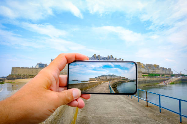 Photographing the walled city of Saint-Malo on the coast of Brittany, France using a modern smartphone stock photo