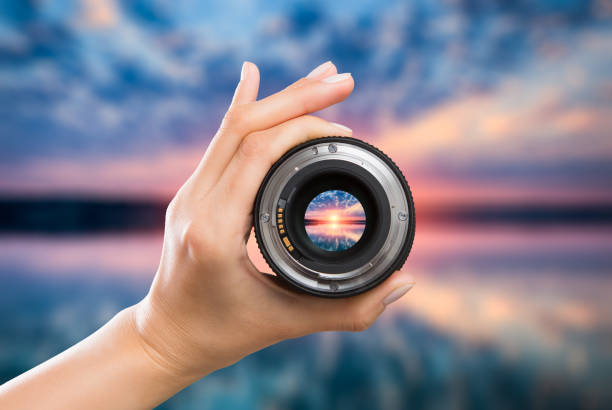 Photography camera lens concept. photography view camera photographer lens lense through video photo digital glass hand blurred focus people sun sunset sunrise cloud sky water lake concept - stock image image focus technique stock pictures, royalty-free photos & images