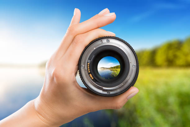 Photography camera lens concept. photography view camera photographer lens lense through video photo digital glass hand blurred focus people concept - stock image image focus technique stock pictures, royalty-free photos & images