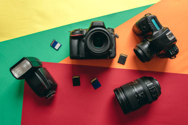 Photography equipment against colorful background stock photo