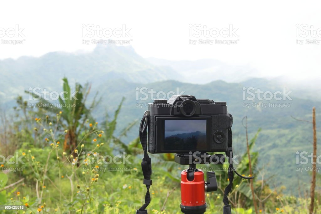 Photography view of digital camera with beautiful mountain background. royalty-free stock photo