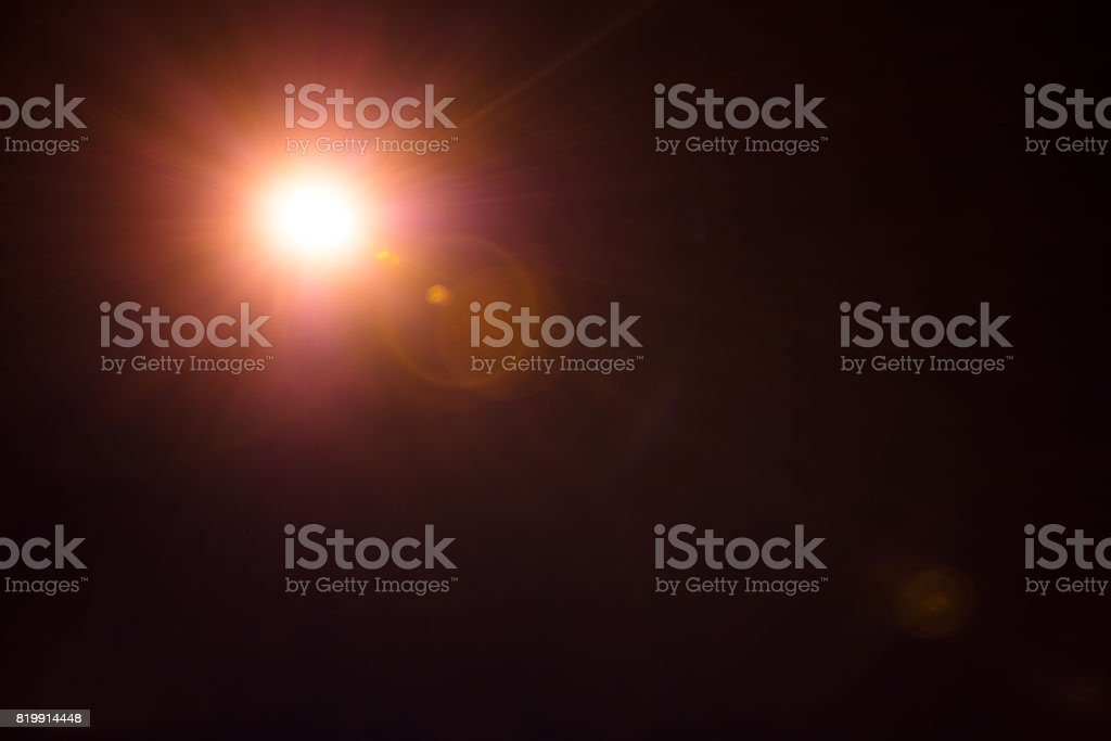 Photorealistic lens flare isolated on black background stock photo