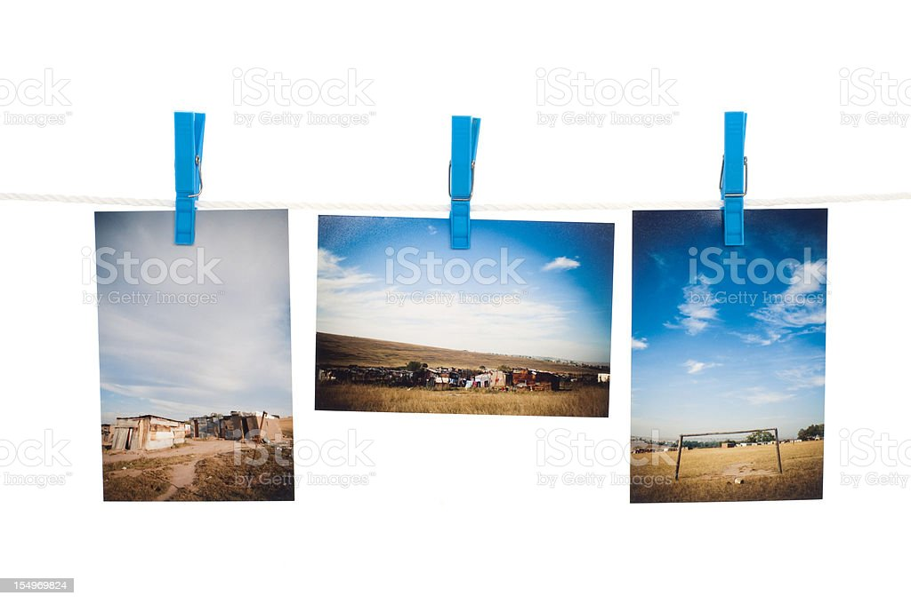 Photos hanging on wire stock photo
