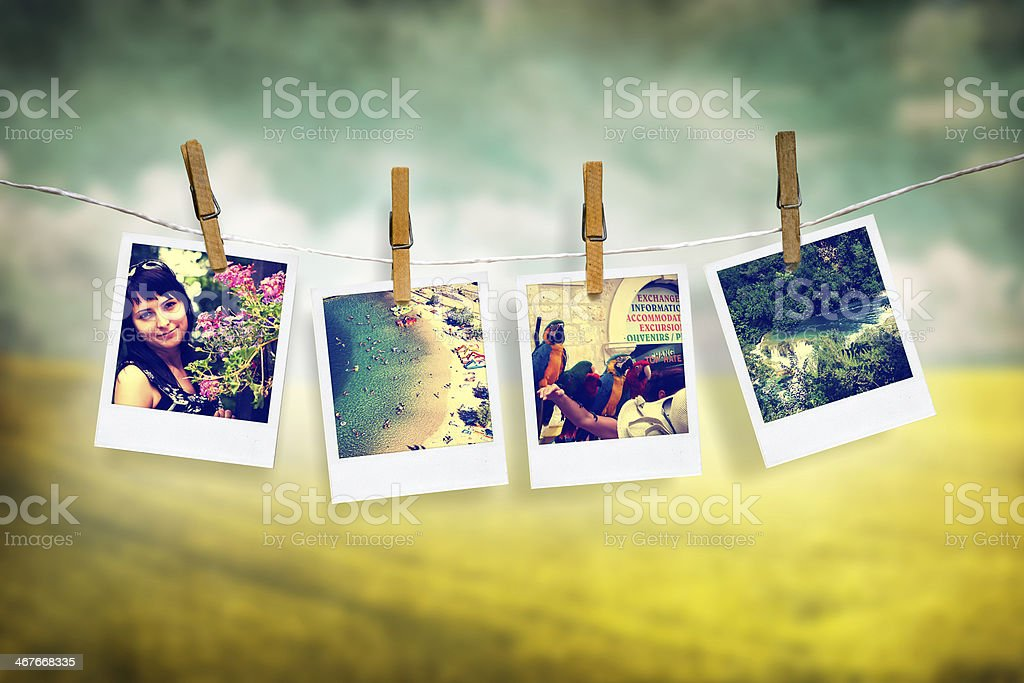 photos of holiday hanging on clothesline with grunge background stock photo
