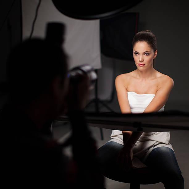 Photoshooting with beautiful woman stock photo