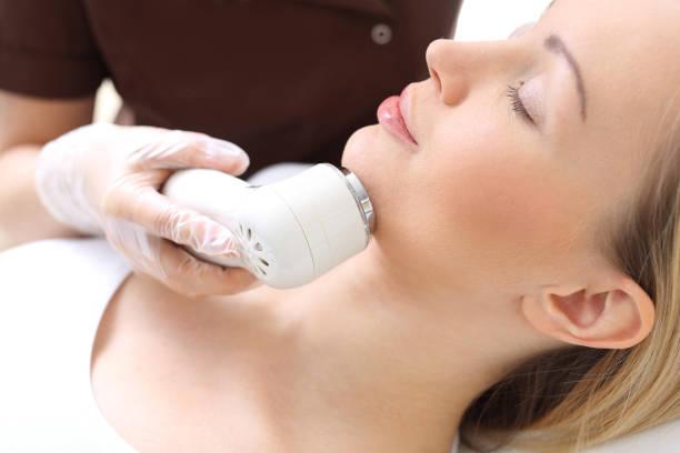 Phototherapy 、女性の美容院 ストックフォト