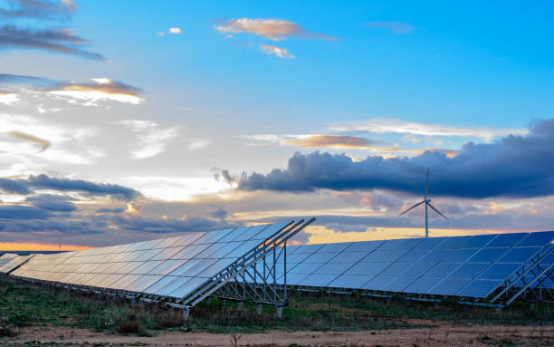 photovoltaic and wind plant at sunset - energia solare foto e immagini stock