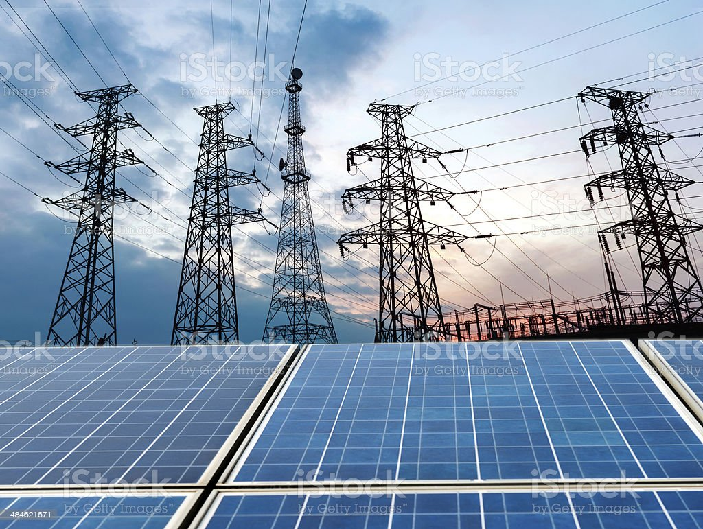 photovoltaic cells and high voltage post. stock photo