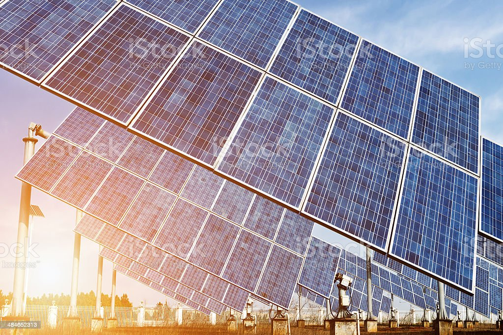 photovoltaic cells and sunset background stock photo