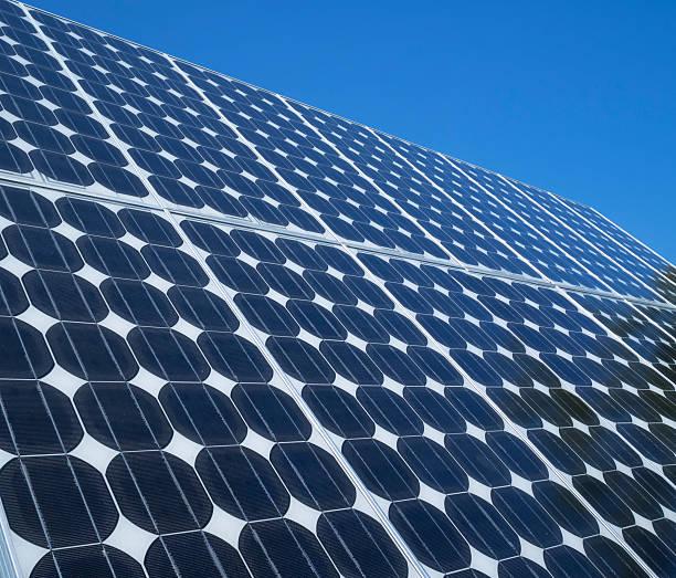 Photovoltaic cells solar panels blue sky stock photo