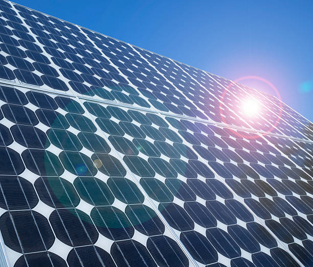 Photovoltaic cells solar panels lens flare stock photo