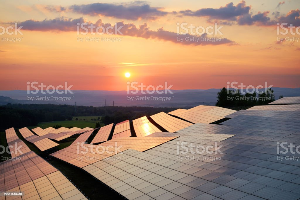 Photovoltaic panels of solar power station at sunset stock photo