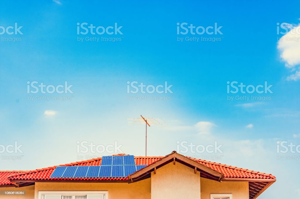 Photovoltaic Power Plant On The Roof Of A House On Sunny Day